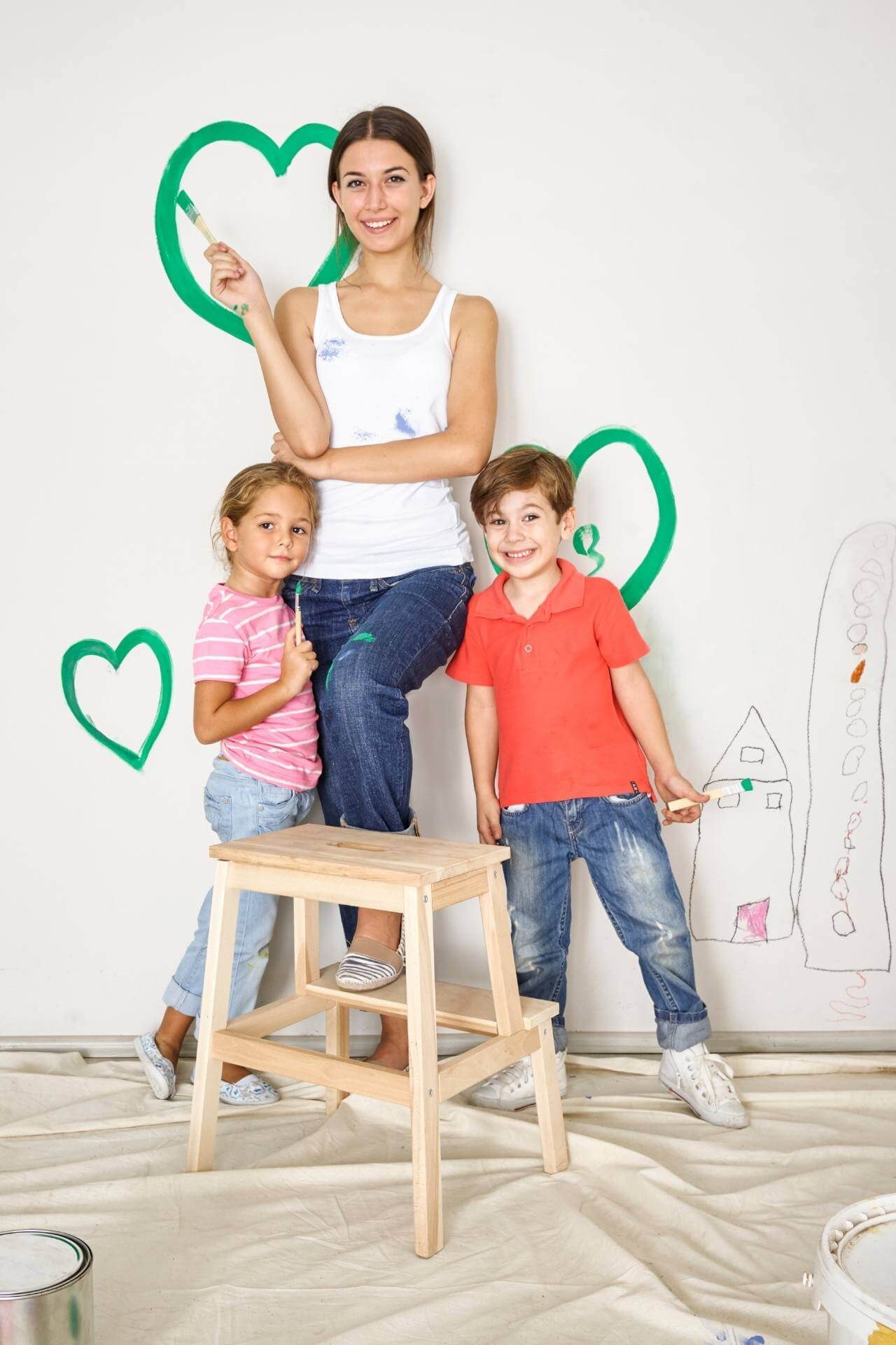 Kids painting with mom